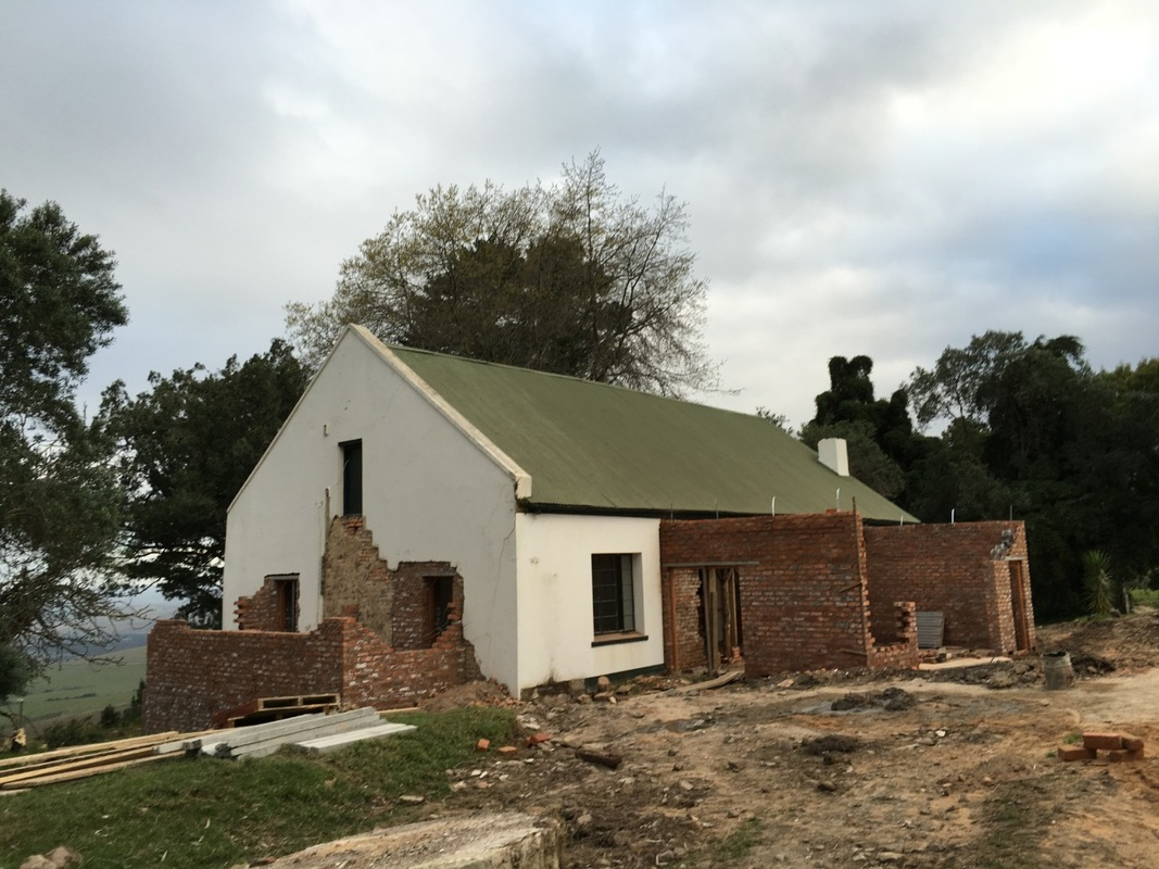 The farm house undergoing construction to expand on the original structure