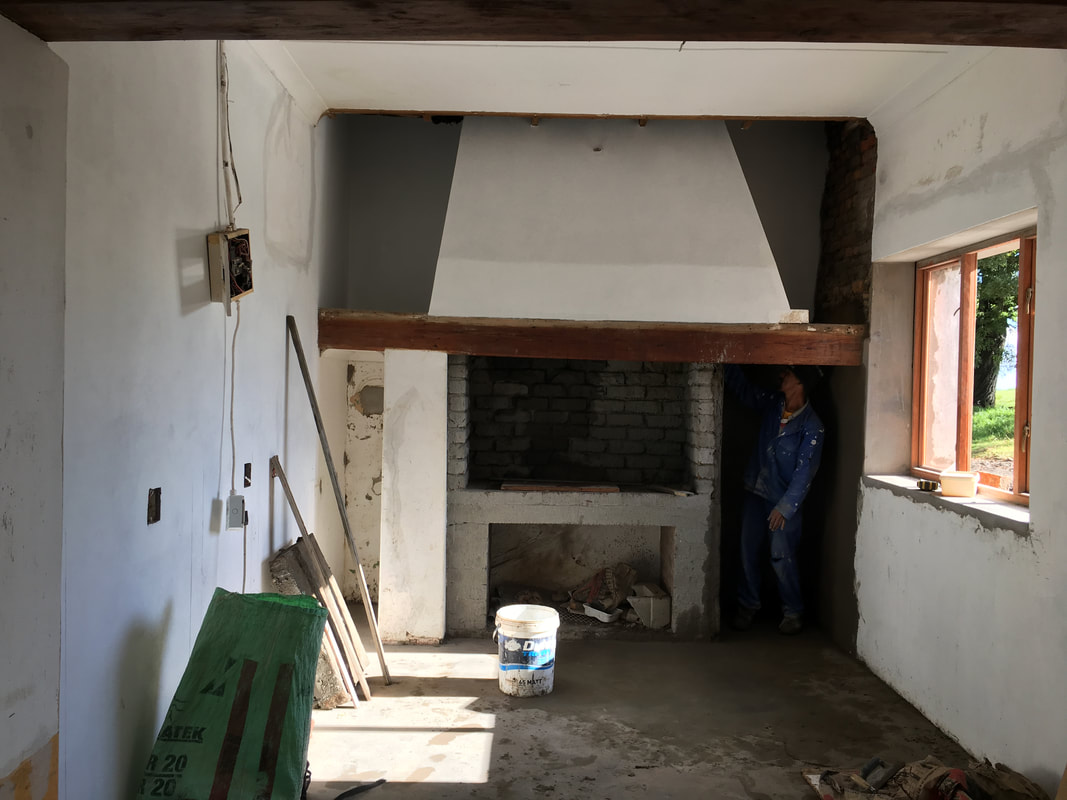 Building the new kitchen around the original fireplace
